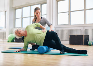 Elderly woman doing pilates